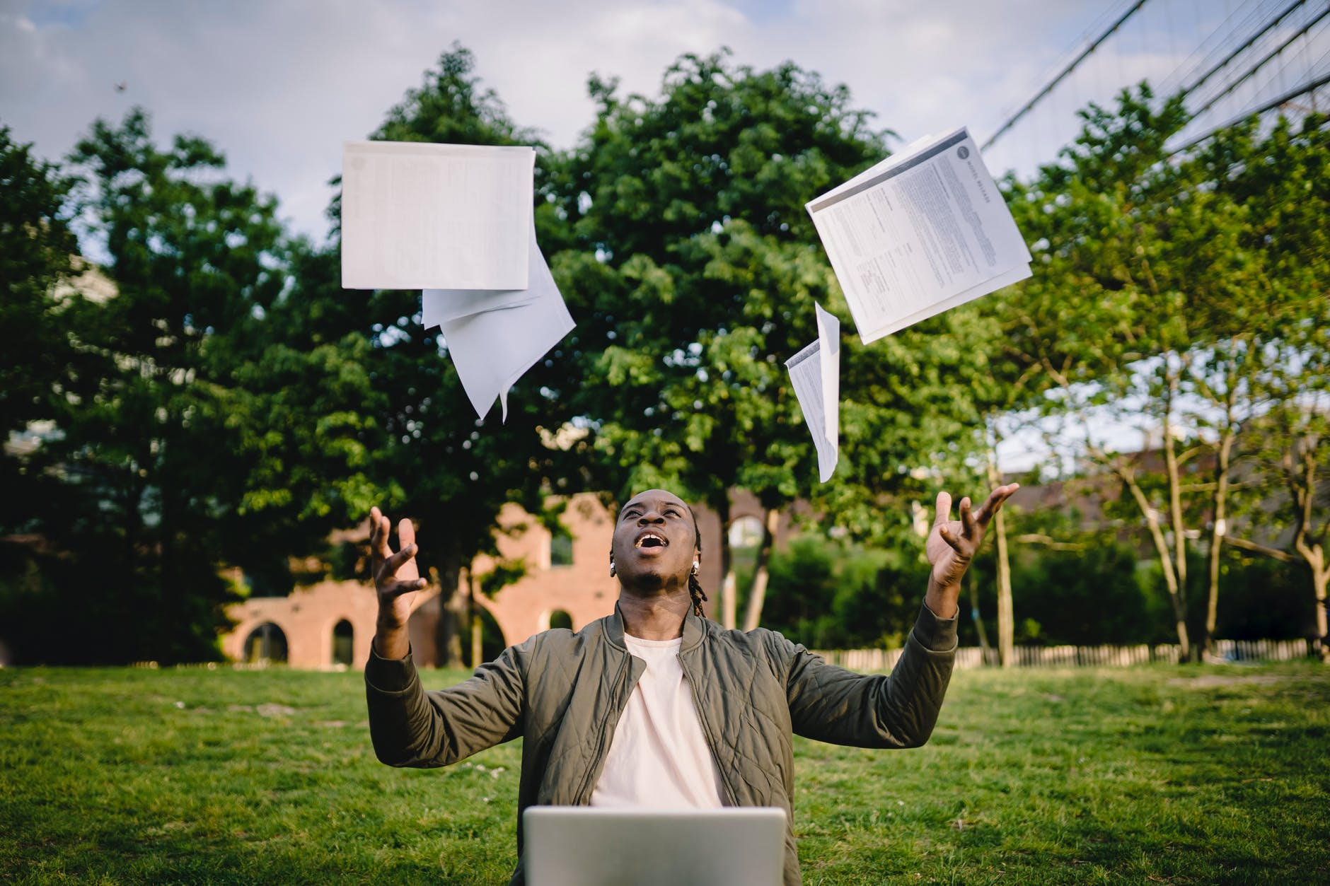 excited african american male student celebrating successful results of exams
